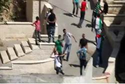 PA Arabs throw rocks in Hebron