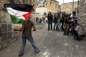 Photographers watching Palestinian stone thrower
